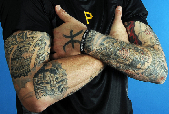 A j burnett tattoos from forbes to federal for Sick tattoo sleeves